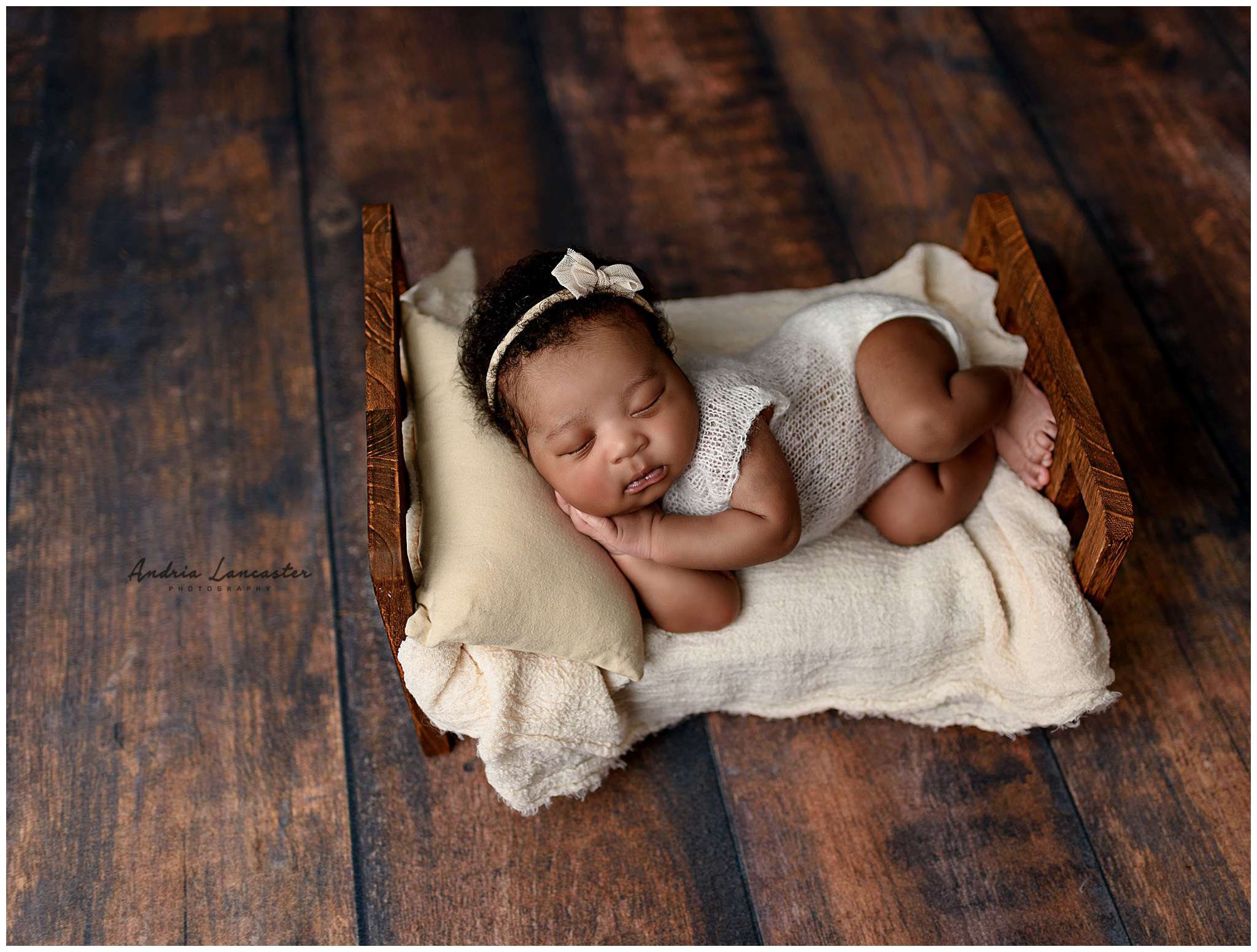 newborn session on bed prop in neutral