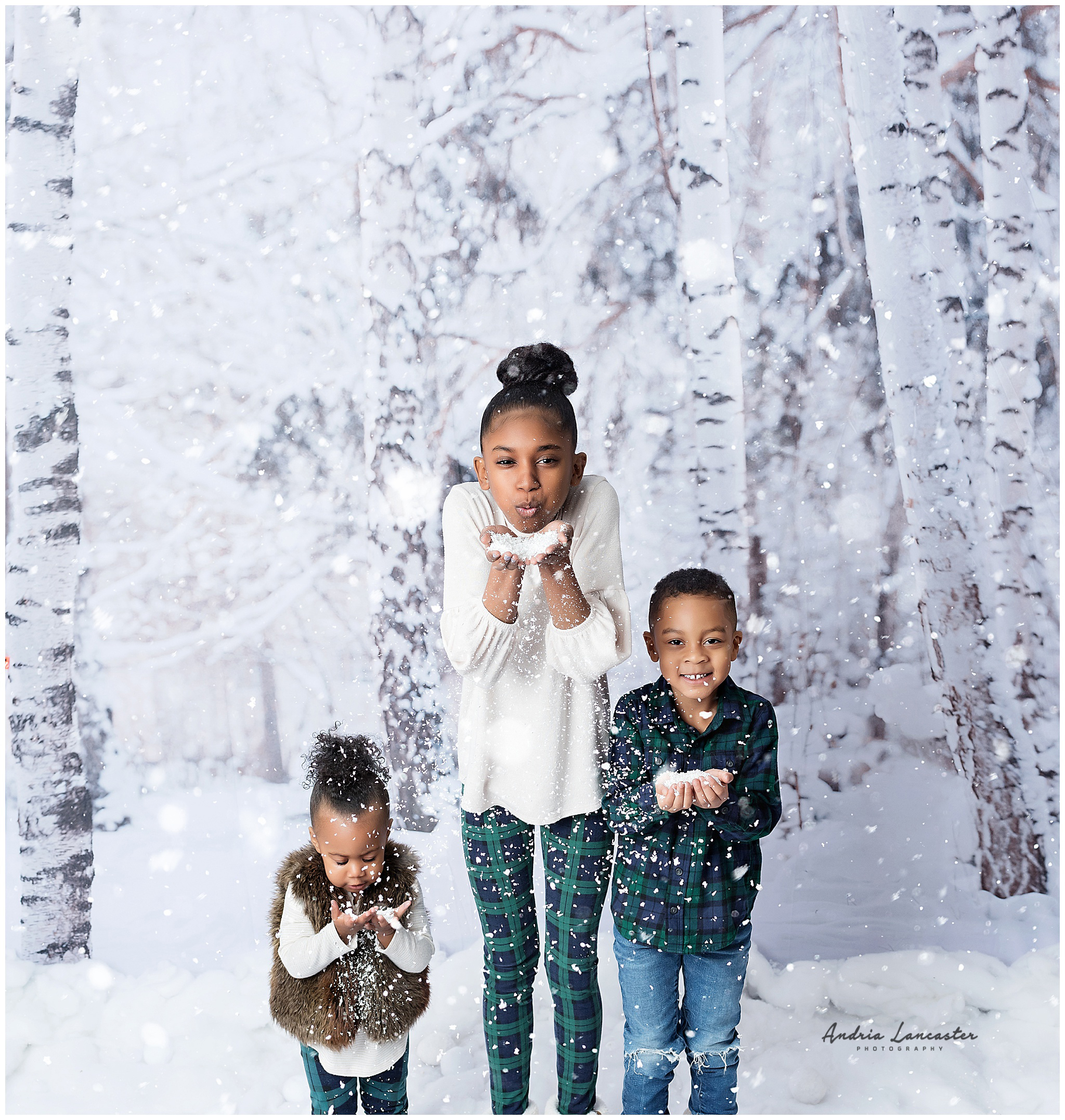 Children blowing faux snow at camera