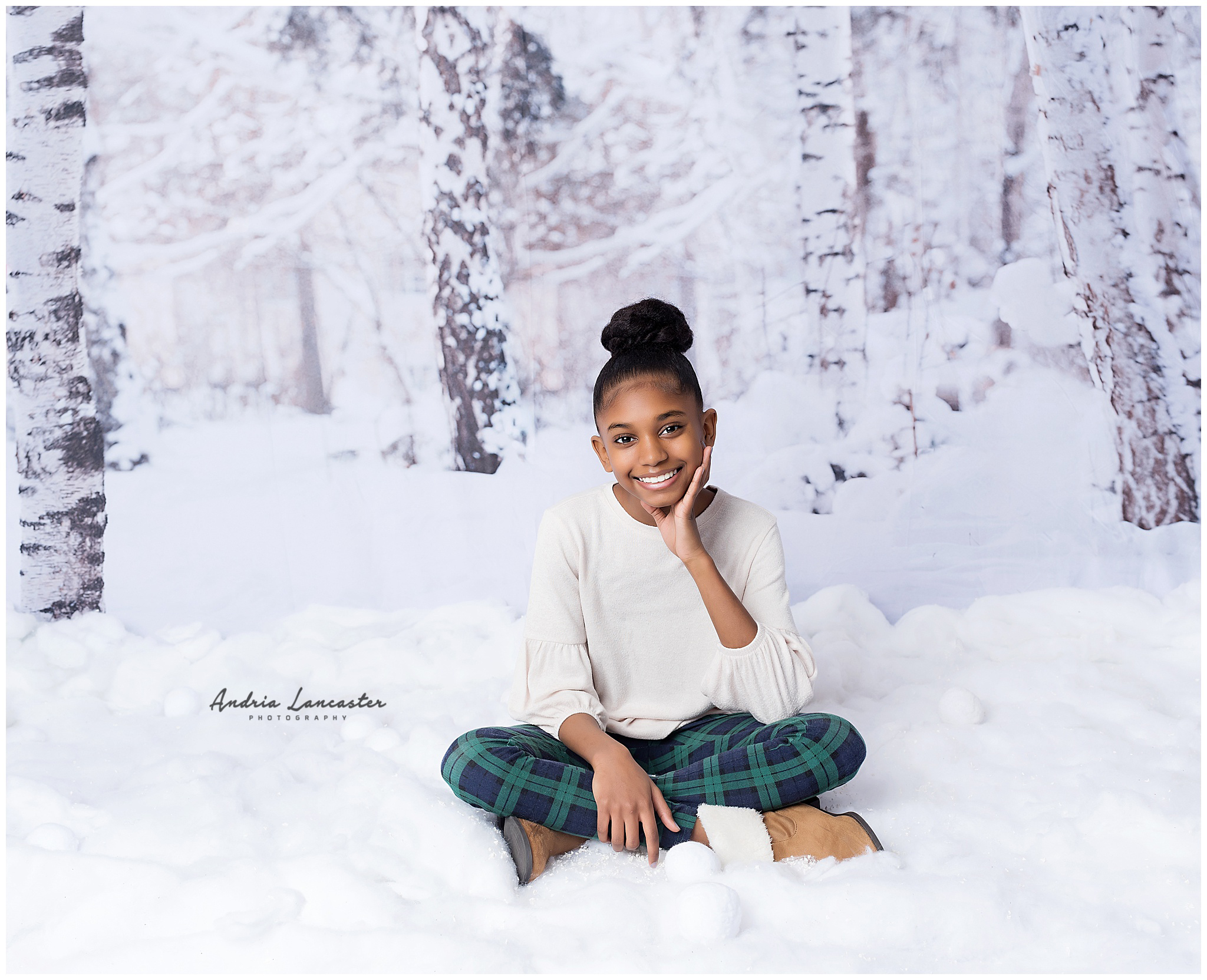Child sitting in faux snow