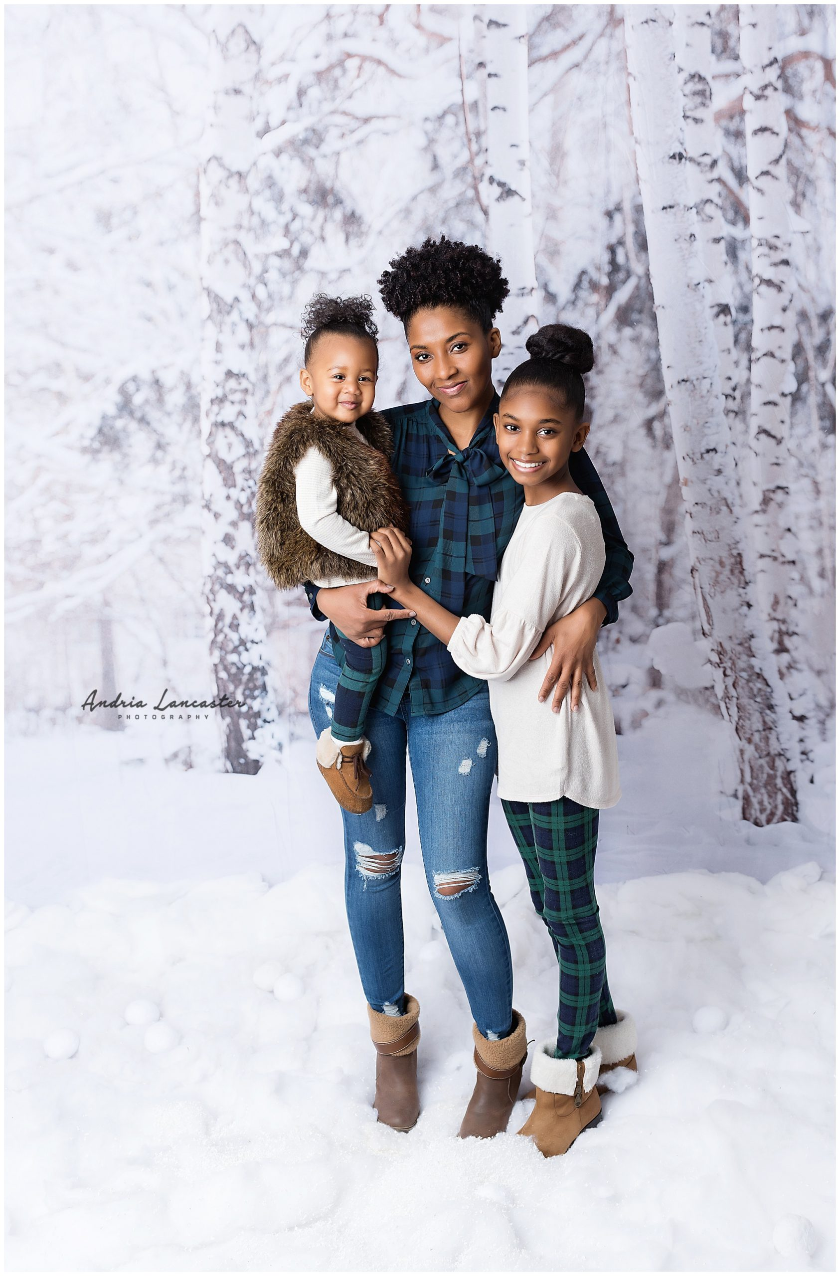 Mom with two girls in faux snow background