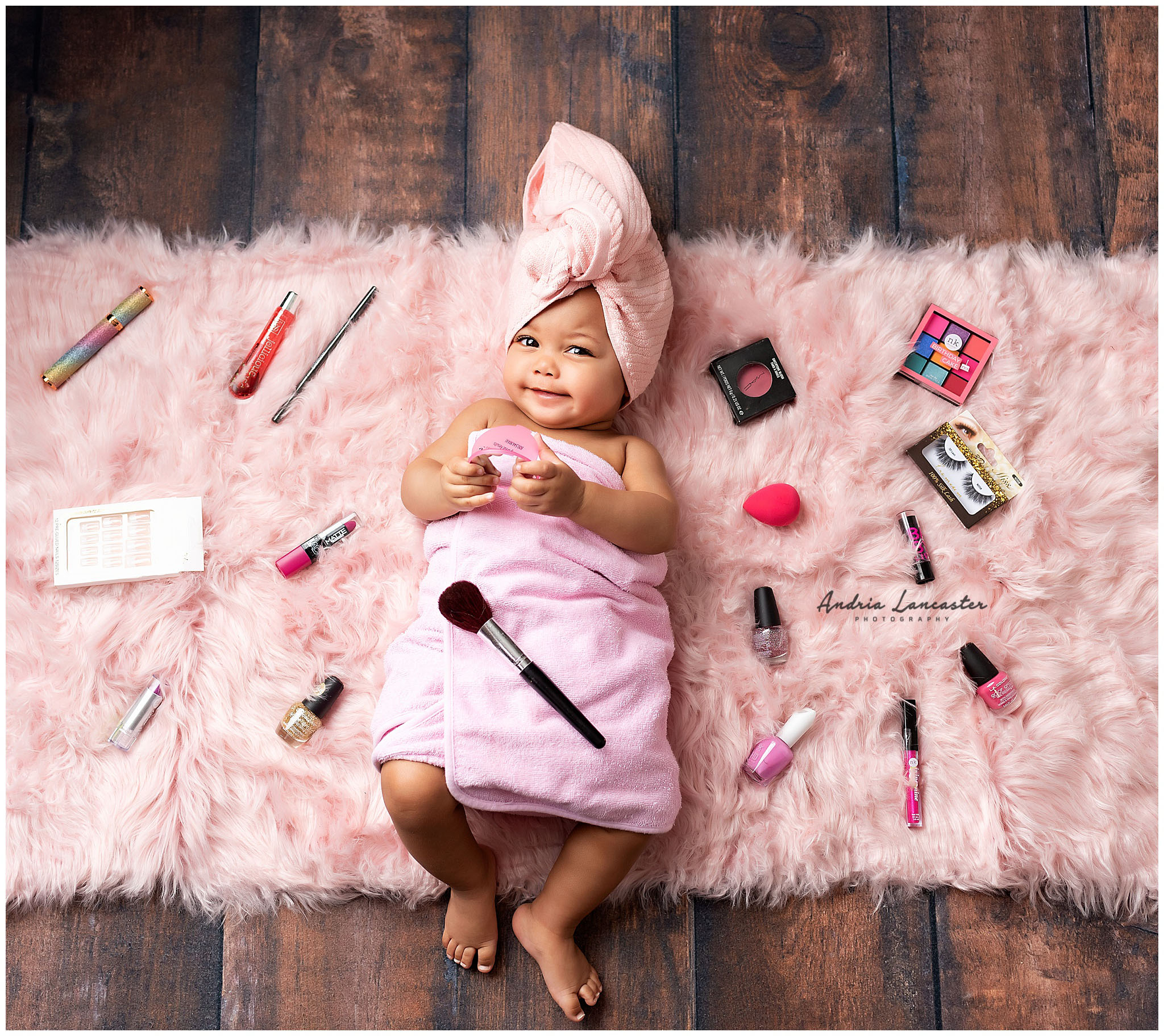 makeup setup on floor with 6 month old in the middle