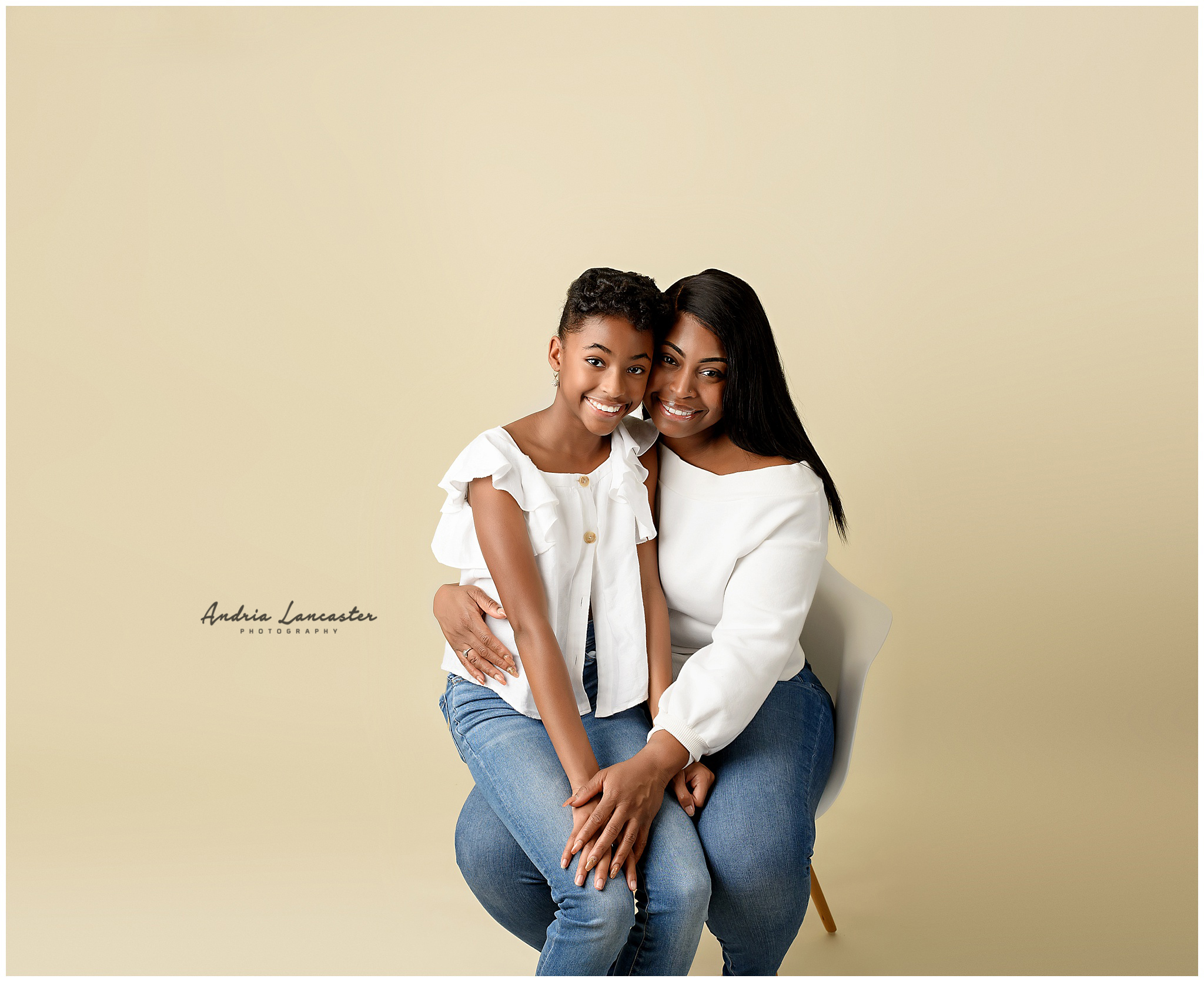 mother posed with daughter sitting on chair
