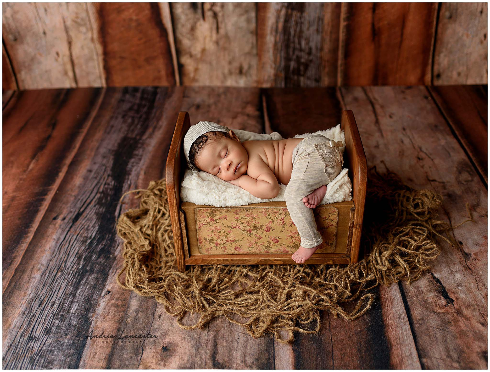 Brooklyn newborn photography session newborn posed with feet hanging off bed prop